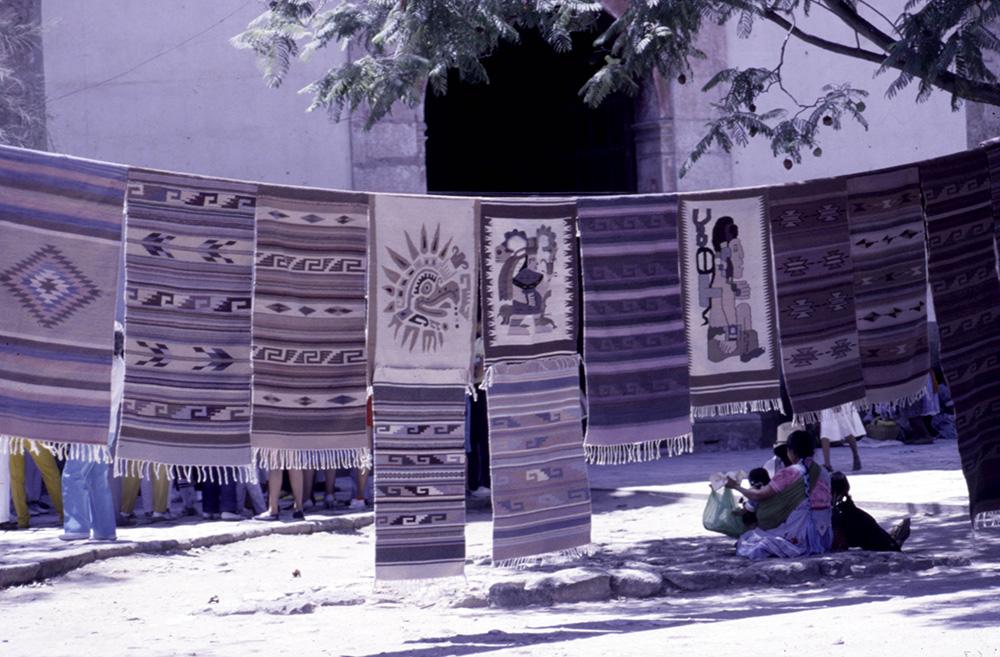 Rugs using Pre-Columbian woven designs on sale in Tlacolula market, Oaxaca